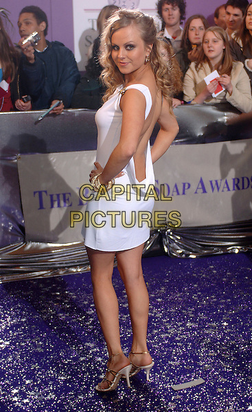 TINA O'BRIEN.The British Soap Awards, BBC Television Centre, London, UK..May 20th, 2006.Ref: BEL.full length white dress backless looking over shoulder hands on hips.www.capitalpictures.com.sales@capitalpictures.com.© Capital Pictures.