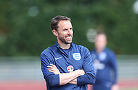 Gareth Southgate, England Manager smiles as he waits for his players during an open England football team training session at Stade Omnisport, Croissy sur Seine, France  on 12 June 2017 ahead of England's friendly International game against France on 13 June 2017. Photo by David Horn/PRiME Media Images.