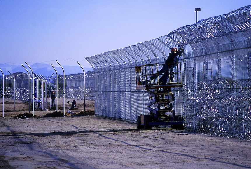 New prison construction in the Western United States, exterior fence. Western United States.