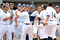 16 May 2010:  FIU's team celebrates Junior Arrojo's (13) eighth inning home run as the FIU Golden Panthers defeated the University of South Alabama Jaguars, 5-0, at University Park Stadium in Miami, Florida.