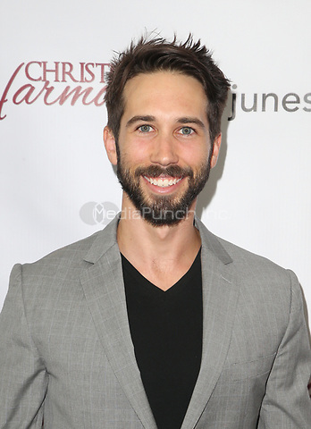 "LOS ANGELES, CA - NOVEMBER 7: Nathan Haugaard, at Premiere of Lifetime's ""Christmas Harmony"" at Harmony Gold Theatre in Los Angeles, California on November 7, 2018. Credit: Faye Sadou/MediaPunch"
