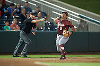 Frisco RoughRiders shortstop Edwin Garcia (11) throws to first as umpire Scott Costello signals fair ball during a game against the Springfield Cardinals on June 3, 2015 at Hammons Field in Springfield, Missouri.  Springfield defeated Frisco 7-2.  (Mike Janes/Four Seam Images)
