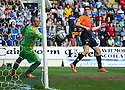 St Johnstone keeper Alan Mannus saves from the head of Dundee Utd's Brian Graham.