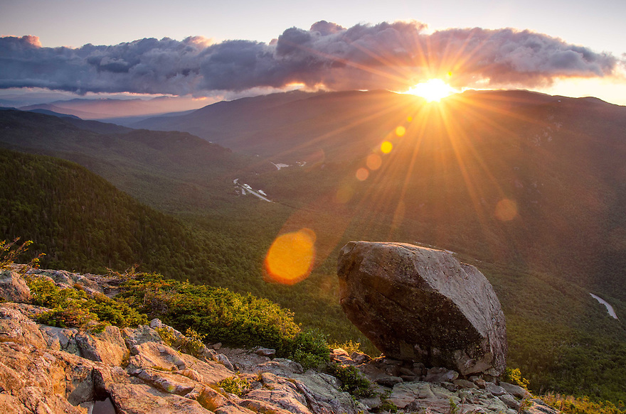 Dawn breaks over the Glen Boulder in New Hampshires White Mountains.