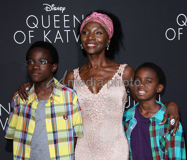 """20 September 2016 - Hollywood, California - Jeryl Prescott with sons. """"Queen Of Katwe"""" Los Angeles Premiere held at the El Capitan Theater in Hollywood. Photo Credit: AdMedia"""
