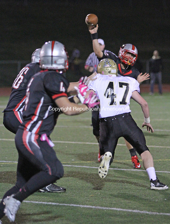 Southbury, CT-101813MK01  Pomperaug's Wade Prajer looks to pass to Robert Tzepos while under heavy presure from Woodland's (#47 NOT ON ROSTER) during NVL-SWC Challenge series on Friday evening at Pomperaug High School in Southbury. Michael Kabelka / Republican-American.