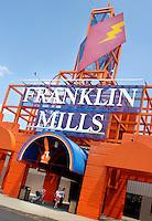 PHILADELPHIA, PA - JUNE 15:  Shoppers walk near one of the entrances to Franklin Mills Mall June 15, 2005 in Philadelphia, Pennsylvania. (Photo by William Thomas Cain)