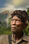 Portrait of a Nage Keo elder. The volcano Mount Ebu Lobo smoulders in the background. Ua Village, near Boawae, Flores, East Nusa Tenggara, Indonesia.