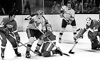 California Golden Seals vs Detroit Redwings, Wings Guy Charron, Rick Newell, and golie Doug Grant..battle Craig Patrick and Walt McKechnie. (1972 photo/Ron Riesterer)