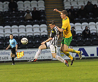 Lewis McLear shooting under pressure from Fiacre Kelleher in the St Mirren v Celtic Scottish Professional Football League Under 20 match played at St Mirren Park, Paisley on 30.4.14.