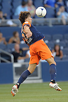 Benjamin Stambouli (22) midfield Montpellier heads the ball..Sporting Kansas City were defeated 3-0 by Montpellier HSC in an international friendly at LIVESTRONG Sporting Park, Kansas City, KS..