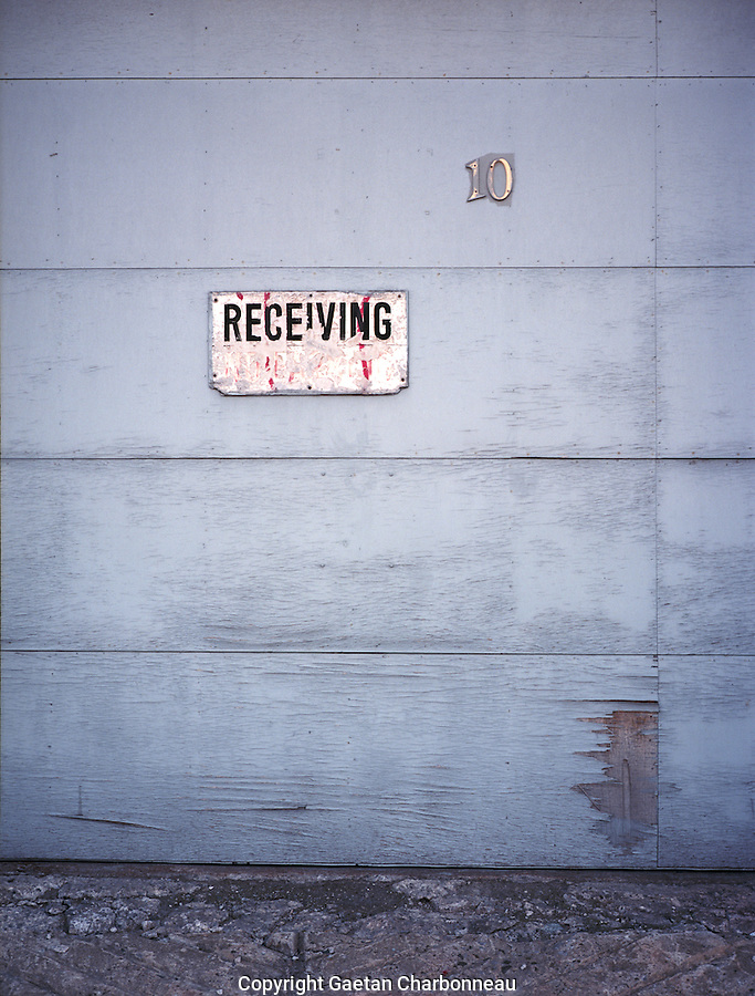 The word receiving on an old wooden door