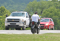 NWA Democrat-Gazette/DAVID GOTTSCHALK An unidentified person Wednesday, June 6, 2018, driving a scooter on an unspecified roadway in the city of Fayetteville.