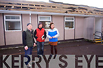 Caretaker Pat Fitzgerald, Graham Foley, windmill glazing, with principal Annette Dineen looking over the storm damage at Listellick NS on Wednesday.