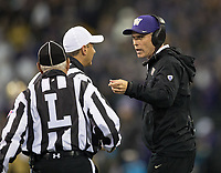 Head coach Chris Petersen interrogates the refs about a non-call on the previous play.