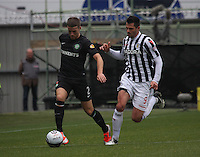 Adam Matthews pursued by Steven Thompson in the St Mirren v Celtic Clydesdale Bank Scottish Premier League match played at St Mirren Park, Paisley on 20.10.12.