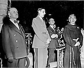 Paris, France - August 26, 1944 -- General Charles De Gaulle, second from left, at the service in the Cathedral of Notre Dame in Paris, France on August 26, 1944.  The crowd had to be held back from crowding when he arrived.  Bursts of gunfire came from the roof and the General was rushed inside.  Then shots rang out from the balcony after the service began, many women and children being among the wounded.  The shots were fired by collaborationists and Germans in civilian clothes..Credit: U.S. Army via CNP