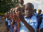 Students clap as they sing at the beginning of the day in a primary school in Bunj, South Sudan, sponsored by Jesuit Relief Service. The community is host to more than 130,000 refugees from the Blue Nile region of Sudan. JRS, with support from Misean Cara, provides educational and psycho-social services to both refugees and the host community.