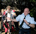 TV presenter Jeremy Clarskon is pied by  protesters against his honorary degree at Brookes,Oxford. On the day of the degreee ceremony.