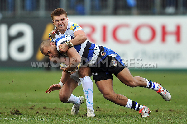 Jonathan Joseph of Bath Rugby is tackled by Henry Slade of Exeter Chiefs. Aviva Premiership match, between Bath Rugby and Exeter Chiefs on December 27, 2014 at the Recreation Ground in Bath, England. Photo by: Patrick Khachfe / Onside Images