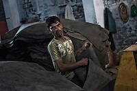 Md. Yusuf (26) is a daily wage labourer in a tannery in Jajmau. He earns about 100.00 USD a month. Work in a tannery is a very hazardous job. Exposure to the harmful chemicals used in the tannery causes skin diseases, respiratory diseases, gastro-intestinal ailments etc. Researches have shown presence of elevated amount of chromium in the blood and urine of the workers. Kanpur, Uttar Pradesh, India. Arindam Mukherjee