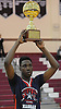 KC Ndefo #21 of Elmont High School hoists the Most Valuable Player trophy after leading Team Nassau to an 87-82 overtime victory over Team Suffolk in the Alzheimer's All-Star Basketball Classic at Bay Shore High School on Sunday, Oct. 23, 2016.