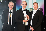 © Joel Goodman - 07973 332324 . 03/03/2016 . Manchester , UK . Michael Hardacre , president of Manchester Law Society , winner Barristers' Chambers of the Year MARK GEORGE QC of Garden Court North (centre) . The Manchester Legal Awards from the Midland Hotel . Photo credit : Joel Goodman