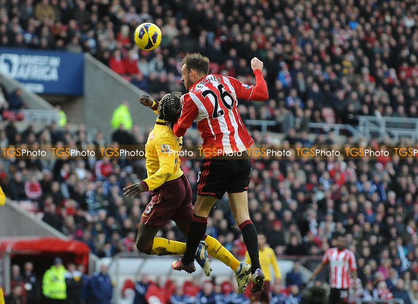 Sunderland striker Steven Fletcher out jumps Arsenal defender Bacary Sagna to head goalward - Sunderland vs Arsenal - Barclays Premier League Football at The Stadium of Light, Sunderland, Tyne & Wear - 09/02/13 - MANDATORY CREDIT: Steven White/TGSPHOTO - Self billing applies where appropriate - 0845 094 6026 - contact@tgsphoto.co.uk - NO UNPAID USE.