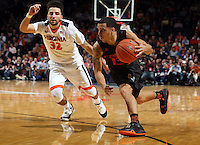 Miami guard Angel Rodriguez (13) drives past Virginia guard London Perrantes (32) during the game Tuesday, Jan. 12, 2016 in Charlottesville, Va. Virginia defeated Miami 66-58. Photo/Andrew Shurtleff