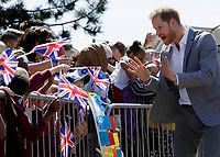 14 May 2019 - Prince Harry Duke of Sussex, meets children and members of the public in the crowd as he arrives for a visit to Barton Neighbourhood Centre in Oxford. The centre is a hub for local residents which houses a doctor's surgery, food bank, cafe and youth club. Photo Credit: ALPR/AdMedia