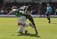 Lewis Stevenson (left) and Nigel Hasselbank tackle in the St Mirren v Hibernian Clydesdale Bank Scottish Premier League match played at St Mirren Park, Paisley on 29.4.12.