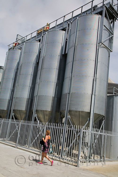 A woman walks past the beer brewing vats at the Little Creatures Brewery in Fremantle, Western Australia, AUSTRALIA.