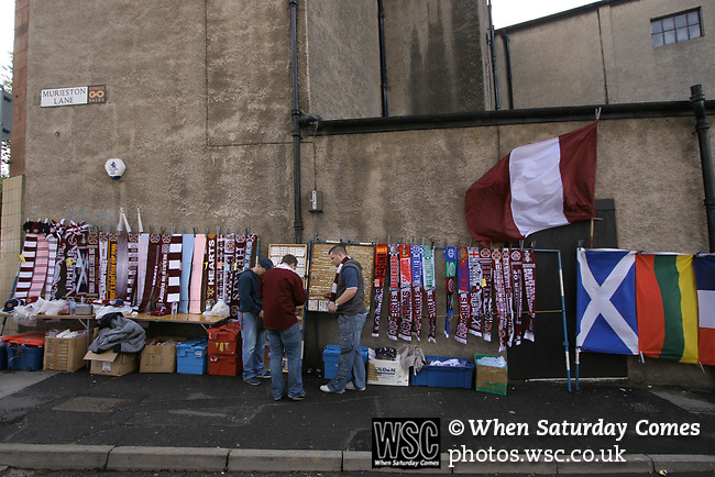 Heart of Midlothian 4 Inverness Caledonian Thistle 1, 26/08/2006. Tynecastle Park, Scottish Premier League. Heart of Midlothian fans buying souvenirs on their way to the team's Tynecastle Park home before a Scottish Premier League game against Inverness Caledonian Thistle. Hearts have been in existence since 1874 and are strongly identified with the Gorgie area of Edinburgh where they play. The club was taken over by a Lithuanian multi-millionaire, Vladimir Romanov in early 2005 and finished runners-up in the league and were Scottish Cup winners in 2005-06. The home team won the match 4-1 watched by 15,912 spectators. Photo by Colin McPherson.