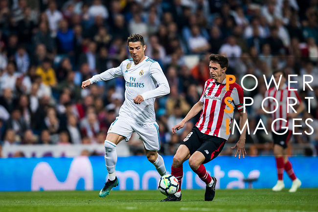 Cristiano Ronaldo (L) of Real Madrid is tackled by Ander Iturraspe Derteano of Athletic Club de Bilbao during the La Liga 2017-18 match between Real Madrid and Athletic Club Bilbao at Estadio Santiago Bernabeu on April 18 2018 in Madrid, Spain. Photo by Diego Souto / Power Sport Images