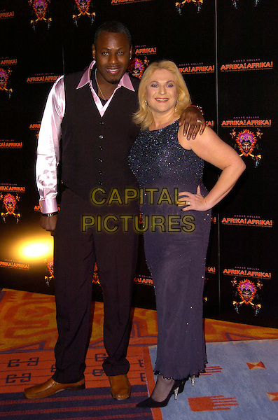 "BEN OFOEDU & VANESSA FELTZ.""Afrika! Afrika!"" VIP premiere, O2 Arena, London, England..January 17th, 2008.full length black waistcoat arm over shoulder blue beads beaded dress hand on hip ring couple trousers.CAP/CAN.©Can Nguyen/Capital Pictures"