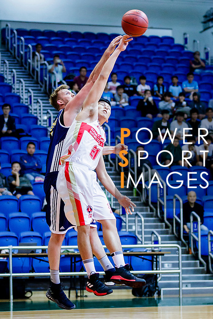Wong Tsz Him #21of Nam Ching Basketball Team vies with Hosford Ian Daniel #5 of Winling Basketball Club during the Hong Kong Basketball League game between Nam Ching vs Winling at Southorn Stadium on May 11, 2018 in Hong Kong. Photo by Yu Chun Christopher Wong / Power Sport Images
