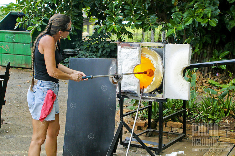 Glass artists hone their skills for curious shoppers to see at some of the unique gift stores in the Northshore Marketplace located near the town of Haleiwa on Oahu's north shore.