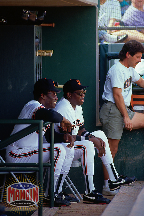 SCOTTSDALE, AZ - Coach Bobby Bonds and manager Dusty Baker of the San Francisco Giants sit in the dugout during a spring training game at Scottsdale Stadium in Scottsdale, Arizona in 1993. Photo by Brad Mangin