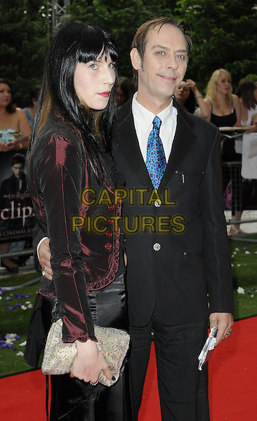 "GUESTS.UK Gala Premiere of ""The Twilight Saga: Eclipse"" at the Odeon Leicester Square, London, England, UK..July 1st 2010.half length black suit jacket burgundy maroon side clutch bag .CAP/CAN.©Can Nguyen/Capital Pictures."