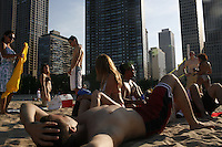 CHICAGO - JULY 8: People relax on the beach in downtown Chicago, July 8, 2007 in Chicago. (Photo by Landon Nordeman).