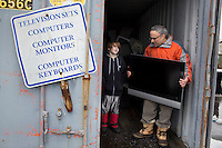 Owen Nannarone, of Scituate, Mass., is a 10-year-old inventor.  Owen likes to take apart and repair electronics and motors.  Seen here at the Scituate Transfer Facility, Owen and his father Len Nannarone frequently visit the dump to look for parts and equipment to use or repair.  He recently developed a prototype for a golf tee that can measure the speed and direction of a golf ball as it's hit.  Two years ago, he developed something called the EZ-Cinch Net, a fishing net with closeable compartments that allow him to collect multiple turtles or frogs from nearby bogs without the animals contacting one another.