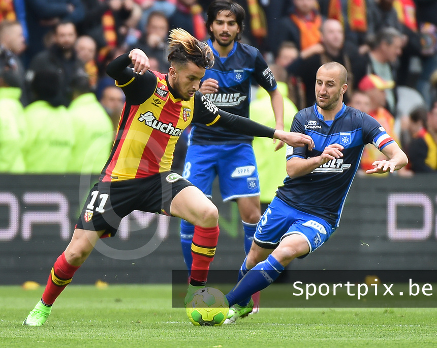 20170415 - LENS , FRANCE : Lens' Abdellah Zoubir (L) and Auxerre's Lionel Mathis (R) pictured during the soccer match between Racing Club de LENS and AJ Auxerre , on the thirty third matchday in the French Dominos pizza Ligue 2 at the Stade Bollaert Delelis stadium , Lens . Saturday 15 April 2017 . PHOTO DIRK VUYLSTEKE | SPORTPIX.BE