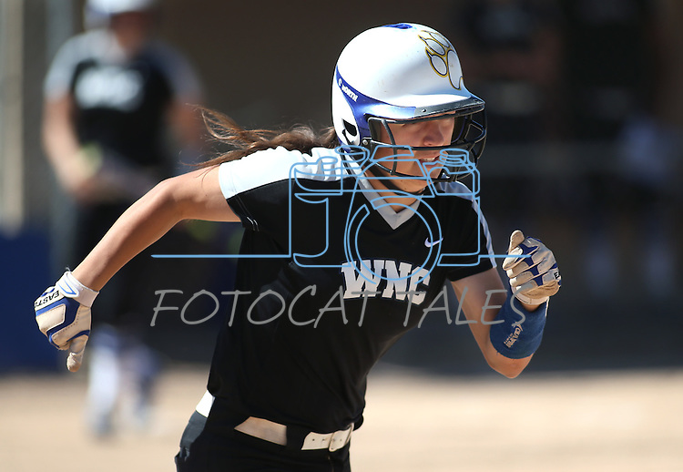 Western Nevada's Melanie Mecham runs up the first baseline against College of Southern Nevada at Edmonds Sports Complex in Carson City, Nev., on Friday, April 1, 2016. <br />Photo by Cathleen Allison/Nevada Photo Source