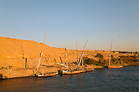 Faluka boats docked along eastern shore of Nile River, near Aswan, Egypt.