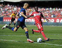 Chicago Fire midfielder Patrick Nyarko (14) defends Manchester United midfielder Gabriel Obertan (26).   Manchester United defeated the Chicago Fire 3-1 at Soldier Field in Chicago, IL on July 23, 2011.
