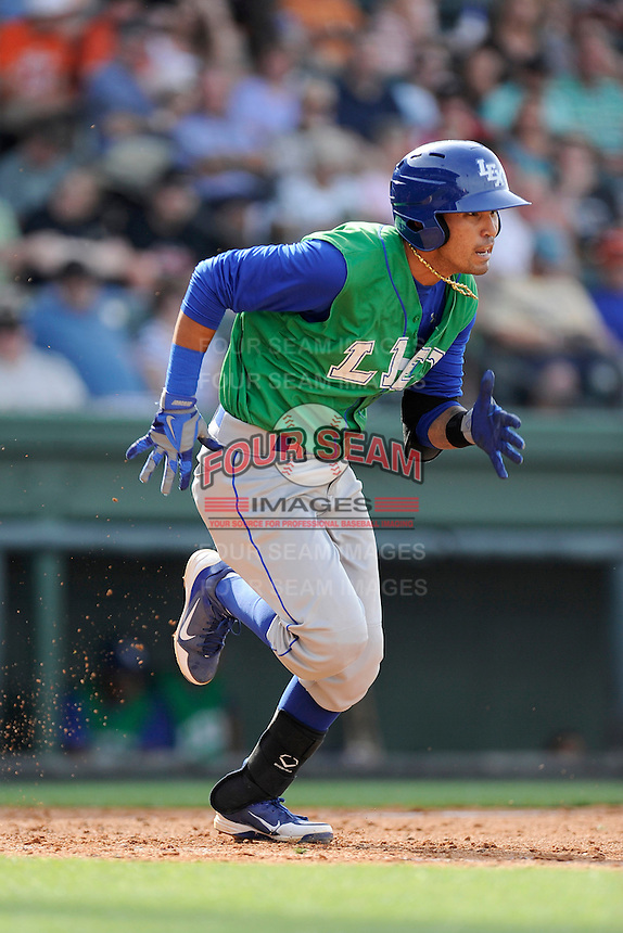 Shortstop Humberto Arteaga (1) of the Lexington Legends in a game against the Greenville Drive on Sunday, April 27, 2014, at Fluor Field at the West End in Greenville, South Carolina. Greenville won, 21-6. (Tom Priddy/Four Seam Images)
