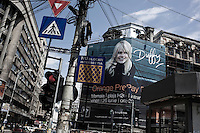 ROMANIA / Bucharest / 25.06.2009 / An ad for a Duffy concert at The Black Sea resort of Mamaia hangs on the facade of The University of Bucharest in University Square or Piata Universitatii.  © Davin Ellicson / Anzenberger