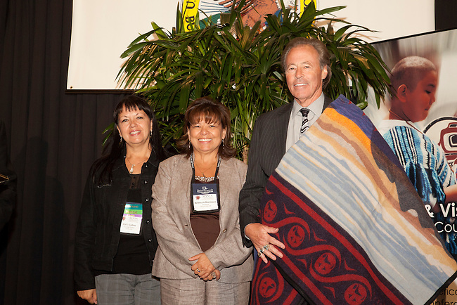Don Chapman, Senior Advisor on Native American Affairs, Office of the Secretary, US Department of Commerce is honored with a Coast Salish blanket during the American Indian Alaska Native Tourism Assoc. Conference in Tulalip , WA. September 2010.