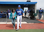 Wildcats' Max Karnos takes the field with his family during Sophomore Day ceremonies at Western Nevada College in Carson City, Nev., on Saturday, April 25, 2015. <br /> Photo by Cathleen Allison