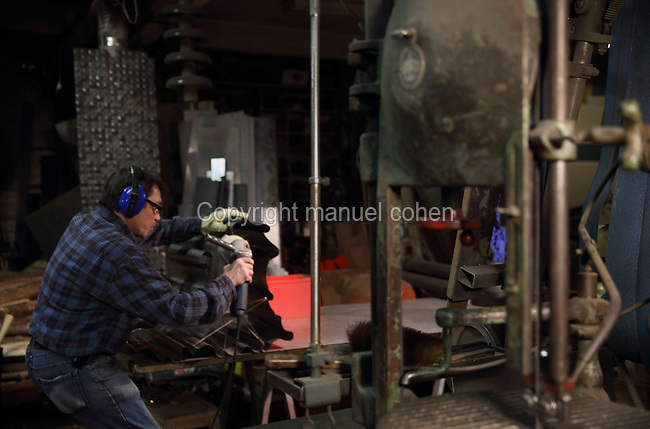 Inside the Soleil Rouge workshop of Nicolas Desbons, metalworker and artist, photographed in 2017, in Montreuil, a suburb of Paris, France. Desbons works mainly in steel but often in conjunction with other materials such as fibreglass, glass and clay, using both cold metal and forge techniques. He produces both figurative and abstract sculptures as well as furniture and lighting. Picture by Manuel Cohen